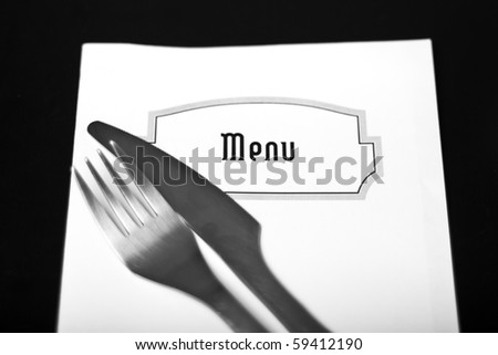 Silverware and a menu on a restaurant table