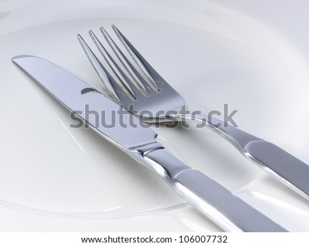 Silverware on a ceramic plate