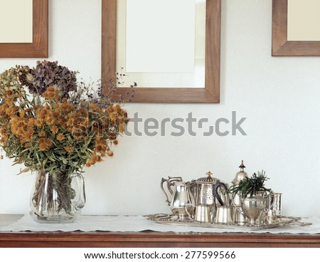 silverware on the old furniture in the living room - stock photo