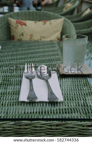 Silverware or flatware set of fork and spoonon rattan table,vintage - stock photo