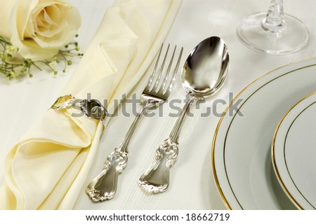 Silverware, Plate And Yellow Rose - stock photo