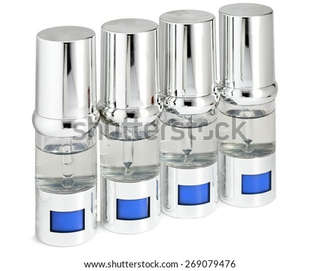 silvery ampoules, small bottles, medical or cosmetic appointment - stock photo