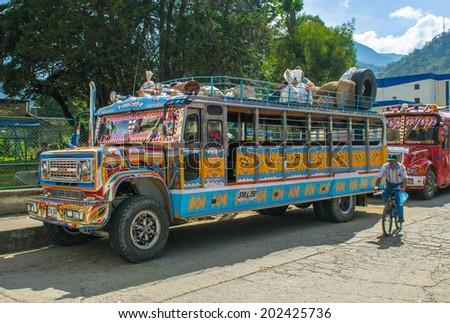 SILVIA, POPAYAN, COLOMBIA - November, 24, 2009: Colorful chiva bus in Silvia village.  - stock photo