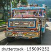 SILVIA, POPAYAN, COLOMBIA - November, 24: Colorful chiva bus in Silvia village on November, 24, 2009 in Silvia, Popayan, Colombia  - stock photo