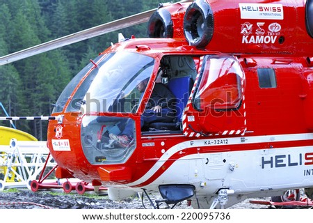 SILVRETTA ALPS,AUSTRIA-CIRCA SEPTEMBER 2014: Helicopter and the pilot, taking part in alpine construction works - stock photo
