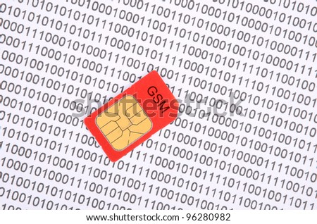 Sim card and binary code - stock photo