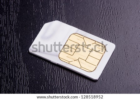 Sim card for mobile communication. Electronic devices. - stock photo