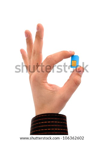 sim card in your hand on a white background - stock photo