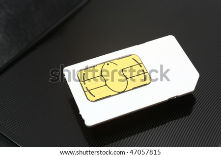 sim card on a black metal background - stock photo