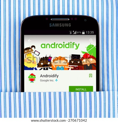SIMFEROPOL, RUSSIA - April 18, 2015: Samsung Galaxy S4 in the pocket displaying Androidify application. Androidify - application for creating avatars based on Android logo - stock photo