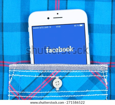 Simferopol, Russia - April 18, 2015: White Apple iPhone 6 in the pocket displaying Facebook application. Facebook is a social network service launched on February 4, 2004 - stock photo