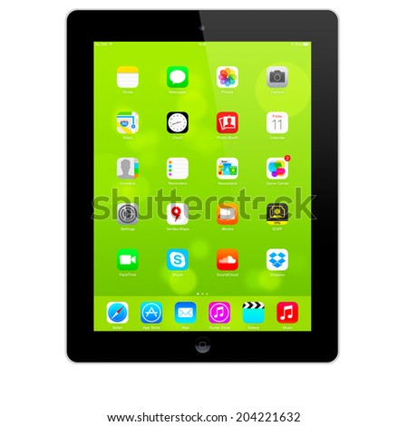 SIMFEROPOL, RUSSIA - JULY 10, 2014: Apple iPad displaying iOS 7.1.2 homescreen. iOS 7.1.2 operating system designed by Apple Inc. Official release of 30 June 2014. - stock photo