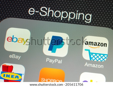 SIMFEROPOL, RUSSIA - JULY 17, 2014: Applications for online shopping on an Apple iPad retina display, which is designed by Apple Inc. Apple iPad Air official released of November 1, 2013. - stock photo