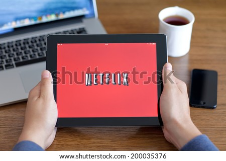 Simferopol, Russia - June 22, 2014: Netflix American company, a provider of films and TV series based on streaming media. The company was founded in 1997. - stock photo