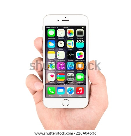 SIMFEROPOL, RUSSIA - NOVEMBER 03, 2014: Apple iPhone 6 silver displaying homescreen. The iPhone 6 and iPhone 6 Plus are smartphones running iOS developed by Apple Inc. - stock photo