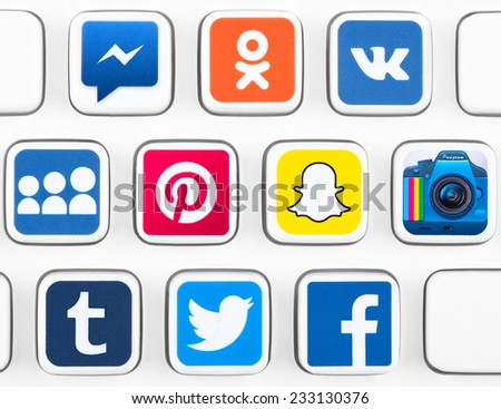 SIMFEROPOL, RUSSIA - NOVEMBER 25, 2014: Popular logotypes of social networking applications printed on sticker and placed on a buttons of keyboard. Incl.: facebook, instagram, twitter and other - stock photo