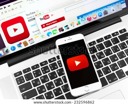 SIMFEROPOL, RUSSIA - NOVEMBER 22, 2014:  Youtube icon on Apple iPhone 6 and Macbook display. YouTube is the popular online video-sharing website, founded in February 14, 2005 - stock photo