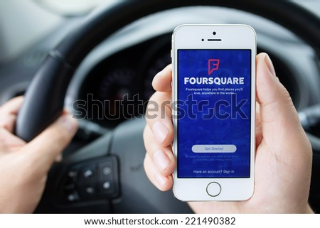 Simferopol, Russia - September 22, 2014: Foursquare social network with geopositioning function. The network generally works with mobile devices. - stock photo