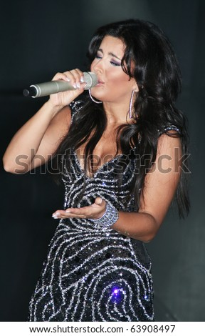 SIMFEROPOL, UKRAINE - May 18: Ukrainian singer Ani Lorak sings at the concert on May 18, 2010 at Palace of culture of trade unions in Simferopol, Ukraine. - stock photo