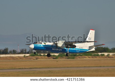 Simferopol, Ukraine - September 12, 2010: Antonov An-24 turboprop passenger plane is taking off from the runway in the airport