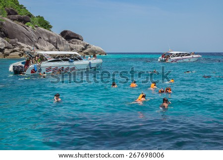 Similan Islands, Thailand Feb 27 , 2015: Travelers are swimming and snorkeling in Andaman sea. Warm and Clear Ocean at Similan island on February 27, 2015 - stock photo