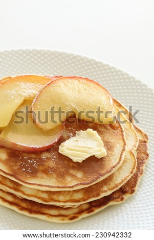 simmered caramel apple and butter on pan cake for gourmet breakfast image