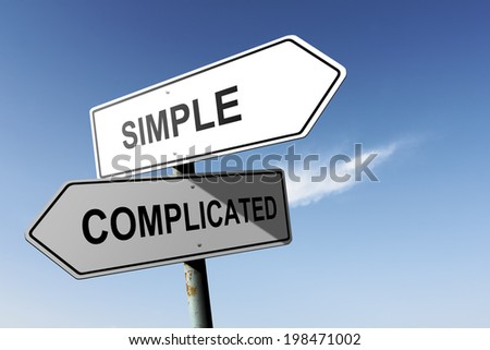 Simple and Complicated directions. Opposite traffic sign. - stock photo