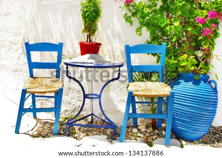 simple charming greek tavernas - stock photo