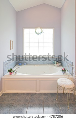 simple clean bathroom with whirlpool - stock photo