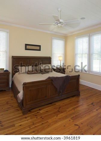 simple cozy master bedroom - stock photo