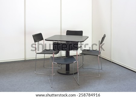 Simple Desk and Four Chairs - stock photo