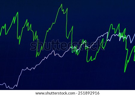 Simple economic chart with two crossed lines showing movements of financial instruments for trading techniques, on a blue background. - stock photo