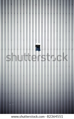 Simple empty steel factory wall with lamp - stock photo