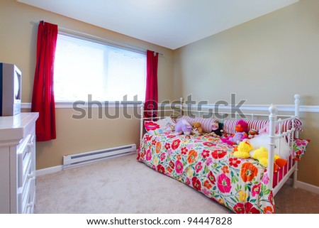 Simple girls bedroom with flowery bedding - stock photo