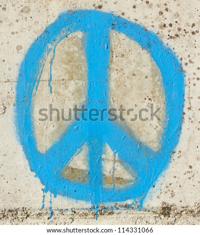 Simple graffity on a concrete wall, a peace sign - stock photo