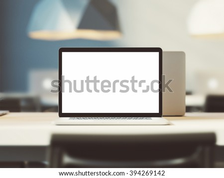 Simple laptop with empty screen on white table. 3d render - stock photo