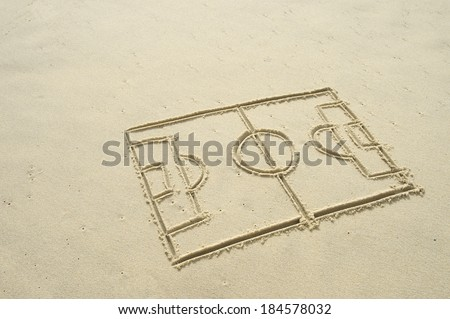Simple line drawing of football pitch in sand on Brazilian beach - stock photo