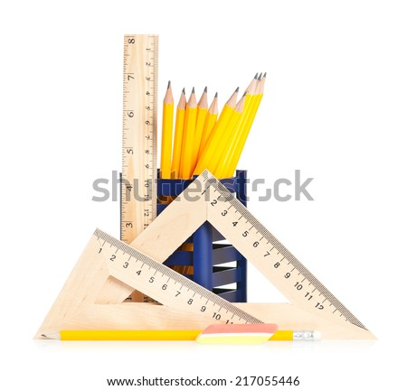 Simple pencils with wooden rulers isolated on white background - stock photo