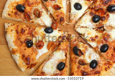 Simple pizza with mozzarella , olives and cherry tomatoes - stock photo