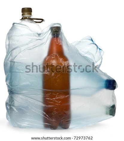 simple plastic bottles in a garbage bag on a white background. - stock photo