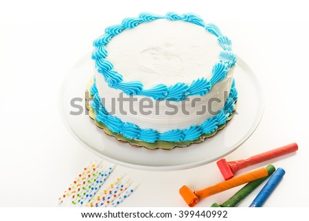 Simple white Birthday cake with white and blue icing. - stock photo