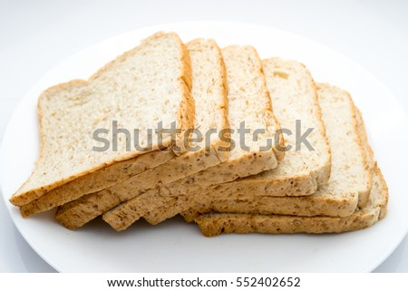 Simple whole wheat bread slice on white dish