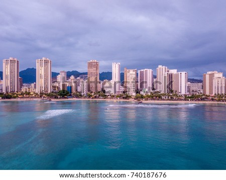 Simply amazing purple sunset over Waikiki beach on the island of Oahu, Hawaii. Honolulu skyline view.