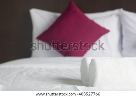 simply modern bedroom and new towel roll. - stock photo