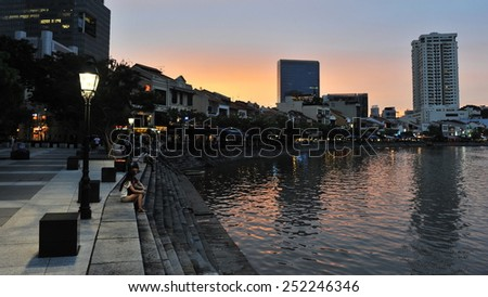 SINAGPORE - MAY 11: Evening view of Boat Quay in the city centre on May 11, 2013 in Singapore. The former British colony has the world's 3rd highest GDP per capita and is home to 5.4 million people. - stock photo