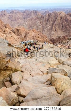 SINAI, EGYPT - NOVEMBER 28, 2013: Unknown tourists go down the long trail from the top of Mount Moses, Egypt - stock photo