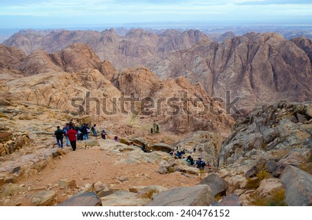 SINAI MOUNTAINS, EGYPT - NOVEMBER 28, 2013:  Unidentified people descend from the top of Mount Moses - stock photo