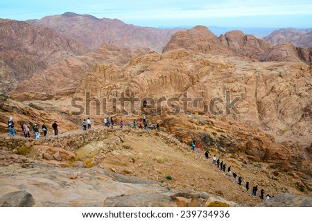 SINAI MOUNTAINS, EGYPT - NOVEMBER 28, 2013:  Unidentified people down from the top of Mount Moses - stock photo