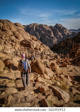 Sinai Peninsula, Egypt - March 7, 2008: Pilgrims hiking down from the top of Mount Sinai, sacred to Muslims, Christians and Jews, in Egypt's Sinai Peninsula. - stock photo