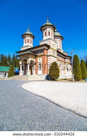 Sinaia, Romania - March 26, 2015: The church at the Orthodox Sinaia Monastery and the partial view of the church inside, Romania - stock photo